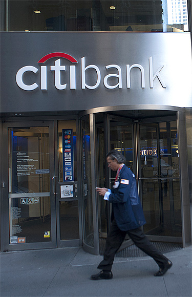 Passersby walk in front of a Citibank branch in New York.