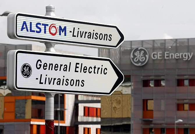Road signs indicate directions for deliveries to French power and transport engineering company Alstom and U.S. conglomerate General Electric sites in Belfort.