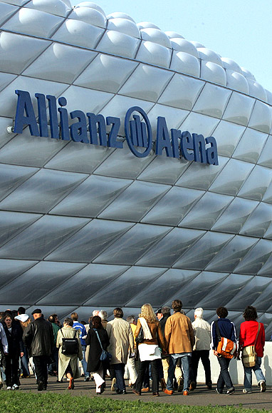 Visitors enter the newly built soccer stadium Allianz Arena.