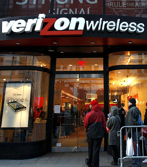 Customers wait in line outside a Verizon Wireless store in New York.