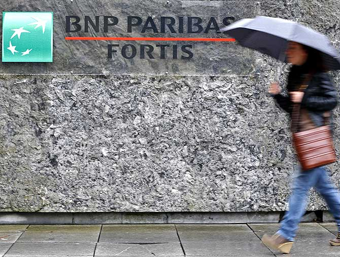 A woman arrives at BNP Paribas Fortis headquarters in Brussels.