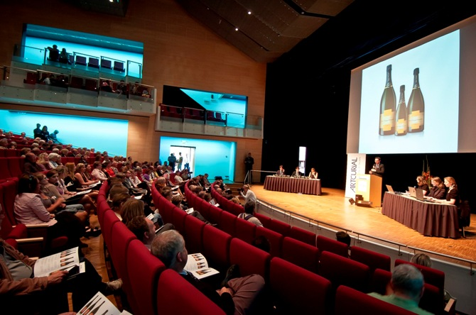 Participants attend an auction for eleven bottles of champagne from the early part of the 19th century, which were found in a shipwreck discovered in the archipelago of Aland Islands, in Mariehamn.