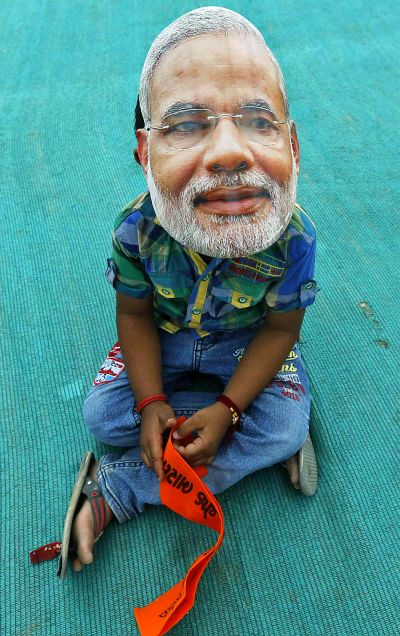 A boy wearing a mask of Hindu nationalist Narendra Modi, prime ministerial candidate for India's main opposition Bharatiya Janata Party.