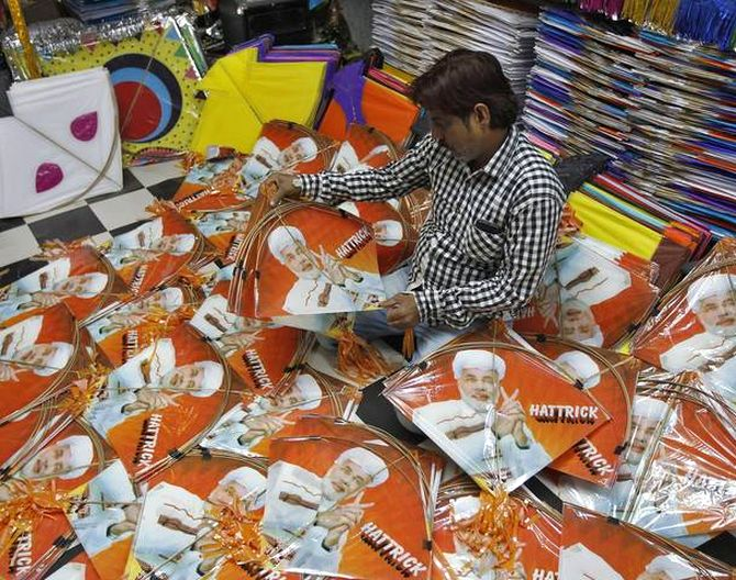 A kite maker counts kites with images of Hindu nationalist Narendra Modi, prime ministerial candidate for India's main opposition Bharatiya Janata Party.