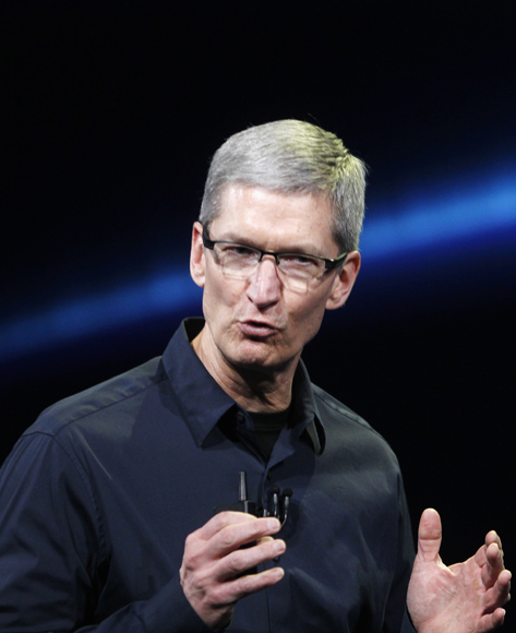 Apple CEO Tim Cook speaks on stage during an Apple event introducing the new iPad.