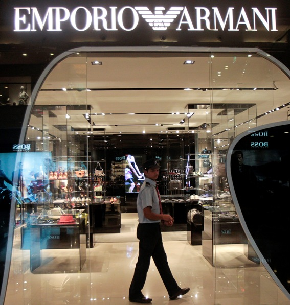 A security guard walks inside a Giorgio Armani showroom in a shopping mall.