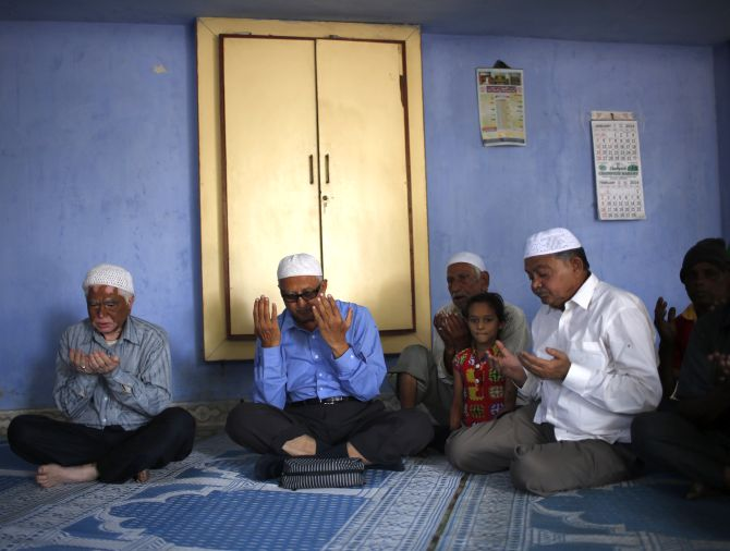 Survivors of the 2002 Gujarat riots offer prayers to mark the 12th anniversary of riots inside a mosque at the Gulbarg Society, a Muslim-dominated housing, in the western Indian city of Ahmedabad.