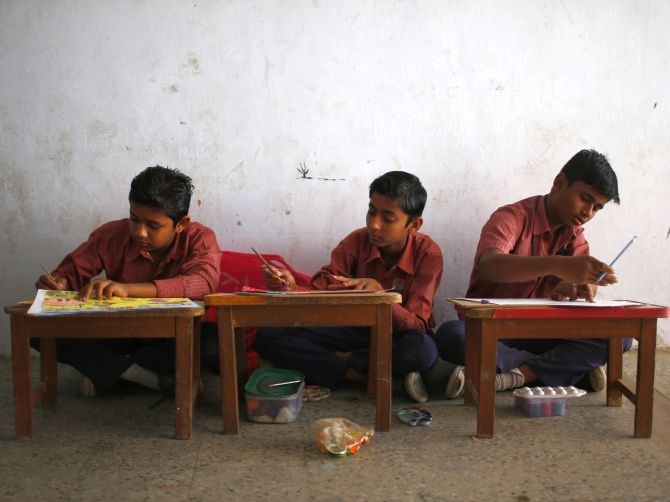 Muslim boys attend a painting class at a school in the Muslim dominated Johapura area in the western Indian city of Ahmedabad.