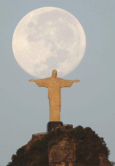 A full moon is seen over the Christ the Redeemer statue in Rio de Janeiro.