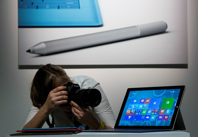 An attendee photographs the new Microsoft Surface Pro 3, during the event in New York May 20, 2014.