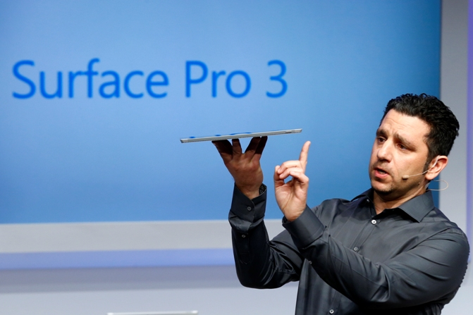 Panos Panay, Corp. Vice President for Surface Computing at Microsoft Corp, unveils the latest models of the Surface tablet in New York May 20, 2014.