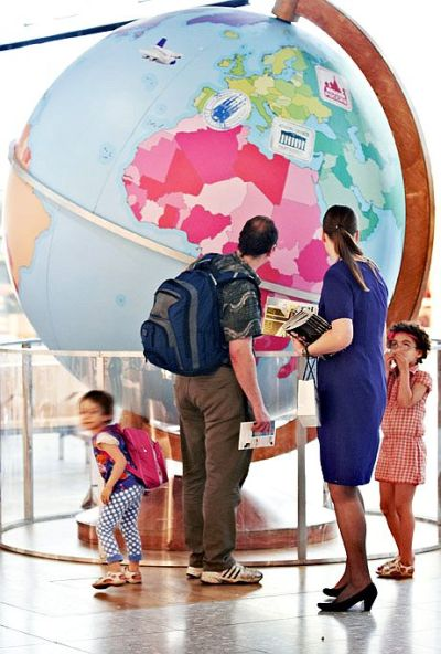 A family checks installation at the Heathrow Airport.