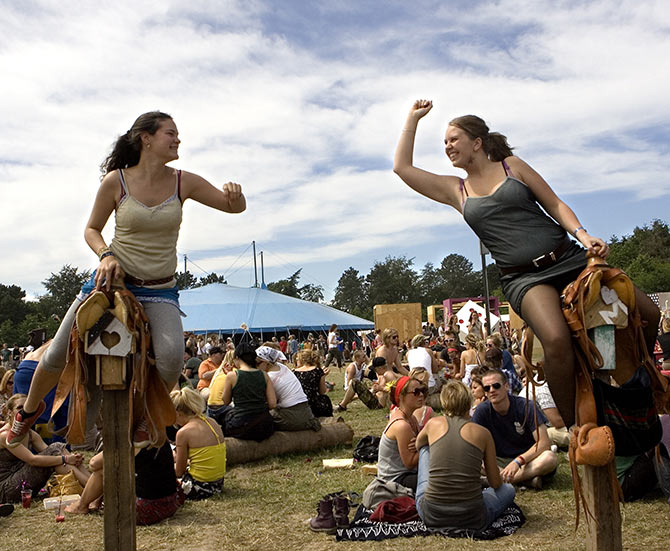 Fans attend the Roskilde Festival which features musicians Bob Dylan, Morrisey, Franz Ferdinand and Roger Waters.