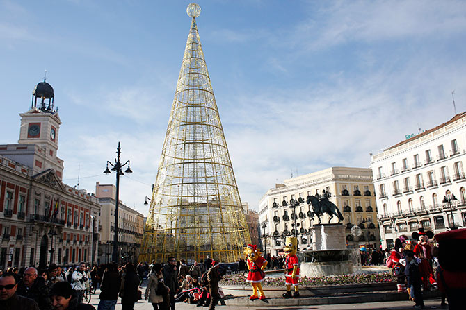 People shop in Madrid's Puerta del Sol square.