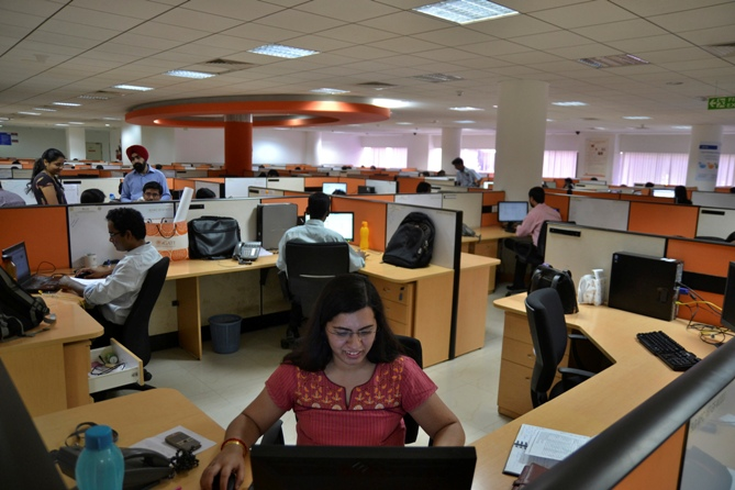Employees work at the Indian headquarters of iGate in Bengaluru.