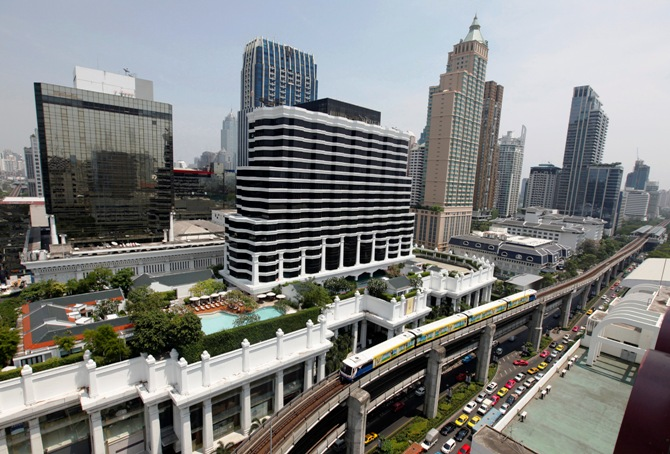 A skytrain passes over vehicles on the road in Bangkok April 4, 2013.