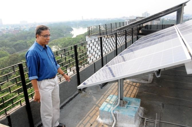 Avijit Ghosh with the solar panels