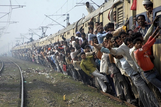 Passengers travel in an overcrowded train in Patna.