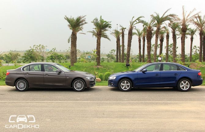 Car Compare Audi A4 Takes On Bmw 3 Series Rediff Com Business