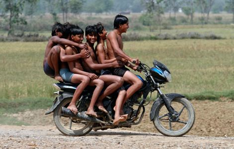 Boys on a motorbike ride back home after they had a bath at the Chachura village canal, in Uttar Pradesh. Parivartan Sharma/Reuters