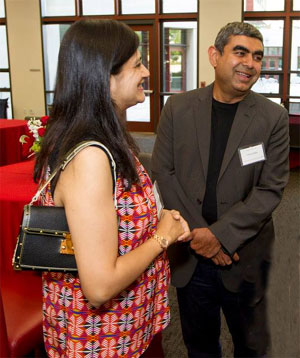 Vandana and Vishal Sikka share a light moment.