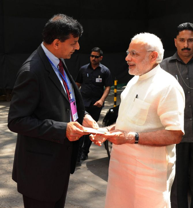 Reserve Bank of India Governor Raghuram Rajan greets Prime Minister Narendra Modi at the RBI headquarters in Mumbai. Photograph: Press Information Bureau