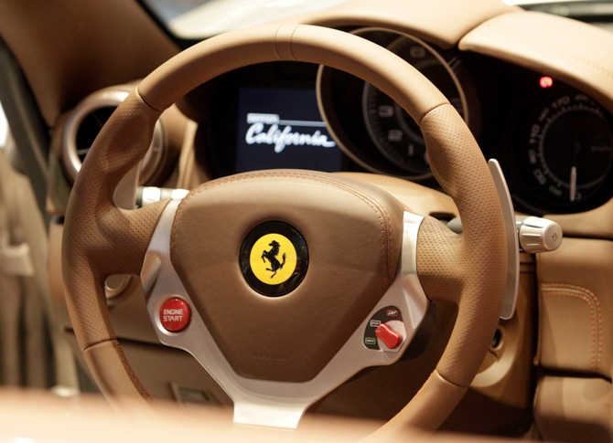 The dashboard of Ferrari California car is displayed at an exhibition.