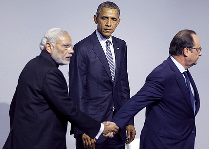 Then US president Barack Obama looks on as Prime Minister Narendra Danodardas Modi and then French president Francois Hollande depart the stage at the Paris climate meet, December 8, 2015. Photograph: Kevin Lamarque/Reuters