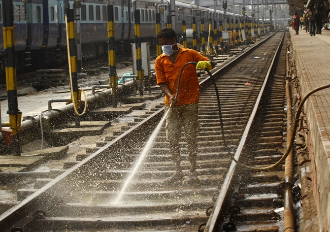 A worker cleans a railway track at a railway station in Kolkata. Rupak De Chowdhuri/Reuters