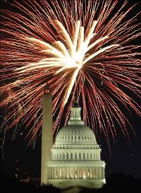 Fireworks explode over the United States Capitol dome and Washington Monument on Independence Day.