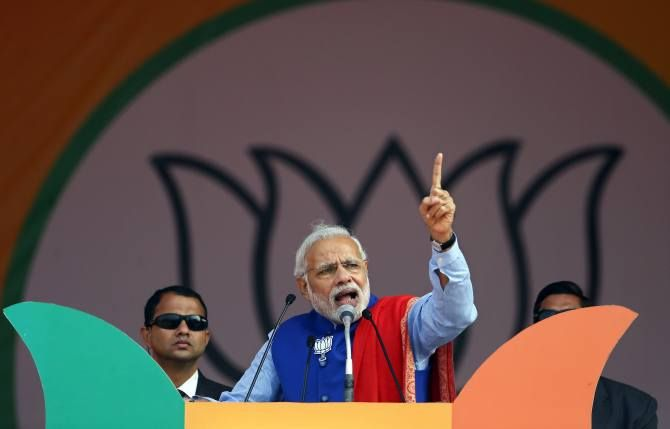 Indian Prime Minister Narendra Modi addresses a campaign rally ahead of state assembly elections, at the Ramlila ground in New Delhi, January 10, 2015.