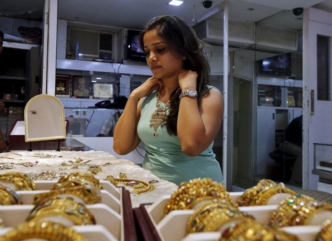 A customer tries out gold jewellery