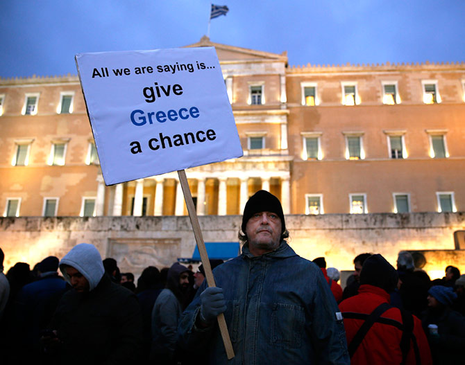 Image: A man takes part in a anti-austerity pro-government demo in front of the parliament in Athens February 11, 2015.