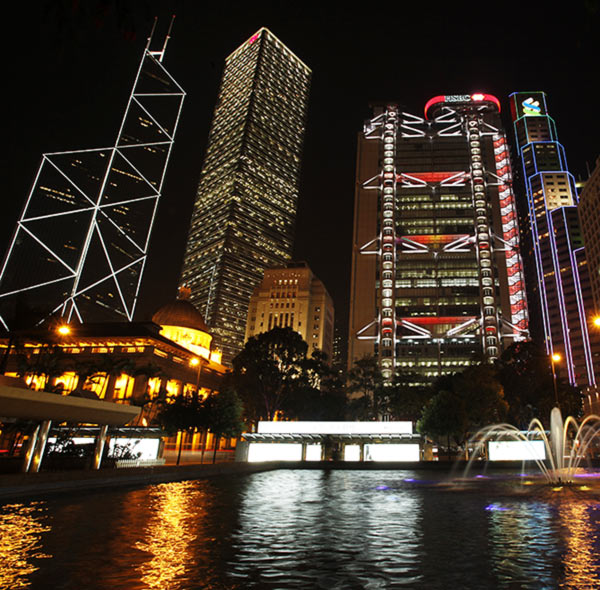 Hong Kong's central financial district's (L-R) Bank of China Tower, Cheung Kong Centre, HSBC headquarters, Standard Chartered Bank and Legislative Council (front L) are pictured lighted up.