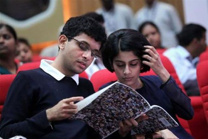 Image: Rohan Murty with his wife, Lakshmi Venu. Photograph: PTI.