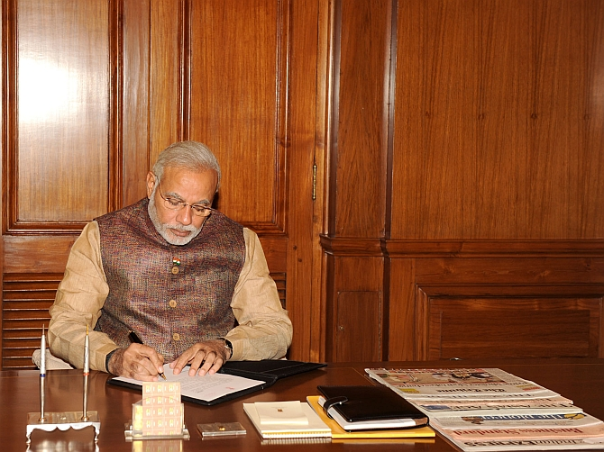 Image: Narendra Modi takes charge of the office of the prime minister at South Block, New Delhi