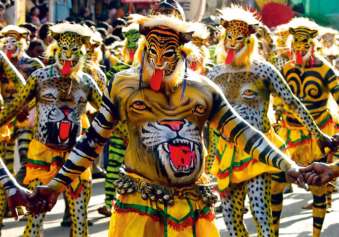 Image: Thrissur's puli kali features men whose bodies are painted with tiger stripes and leopard spots. Photograph: Dipak/Reuters