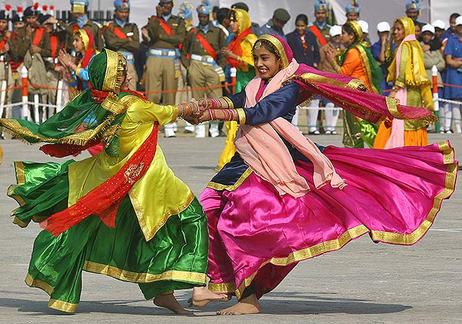 Dancers perform during the Republic Day celebrations in the northern Indian city of Chandigarh January 26, 2011. India celebrated its 62nd Republic Day on Wednesday. Ajay Verma/Reuters