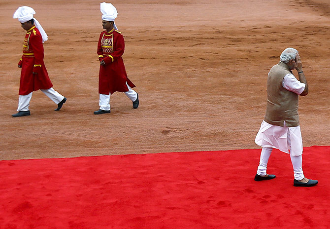 India's Prime Minister Narendra Modi (R) gestures as he leaves after a ceremonial reception