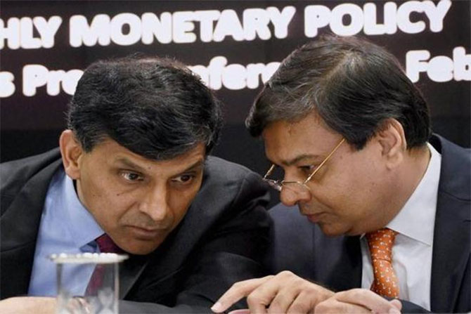 Then RBI governor Dr Raghuram Rajan, left, with his successor Dr Urjit Patel. Photograph: PTI Photo