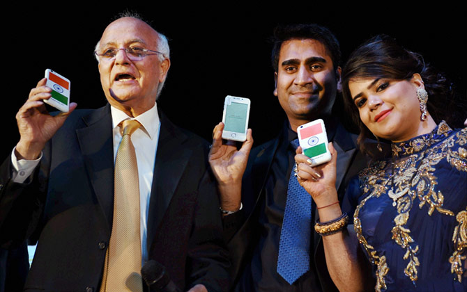 Ashok Chadha, President, Ringing Bells with Director Mohit Goel and CEO, Dhaarna Goel during the launch of Smartphone-Ringing Bells Freedom 251, in New Delhi