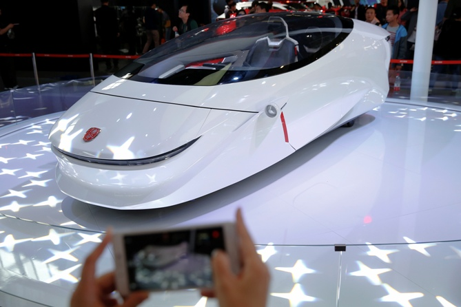 A visitor takes pictures of Luxgen Motor's concept vehicle