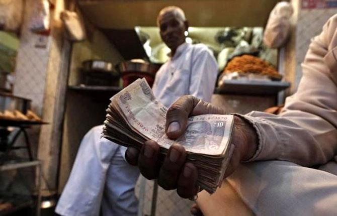 GST to curb black money, April 2017 rollout tough: Experts