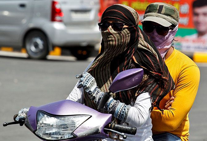 A couple ride a scooter on a hot day in Allahabad, India ApA couple ride a scooter on a hot day in Allahabad, India April 4, 2017. Photo: Jitendra Prakash/Reuterstendra Prakash/REUTERS