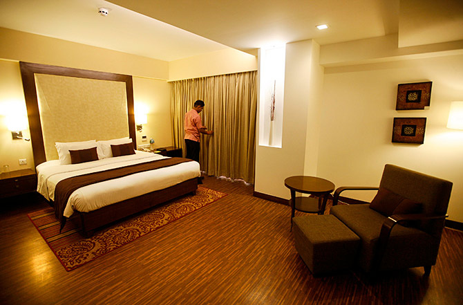 An employee prepares a room at the Four Points hotel, Ahmedabad, April 9, 2013. Photo: Amit Dave/Reuters