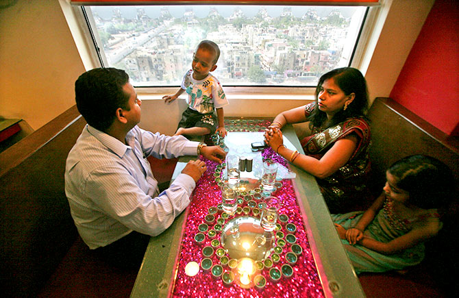 A software engineer and his family at a restaurant at Tata Group's Ginger hotel, New Delhi, May 23, 2012. Photo: Parivartan Sharma/Reuters.