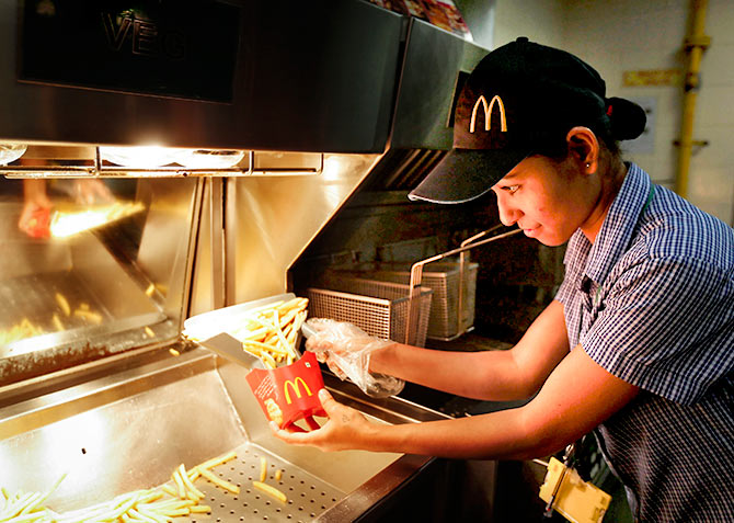 staff member prepares French fries at a McDonald's restaurant in Mumbai February 10, 2015. Photo: Shailesh Andrade/Reuters