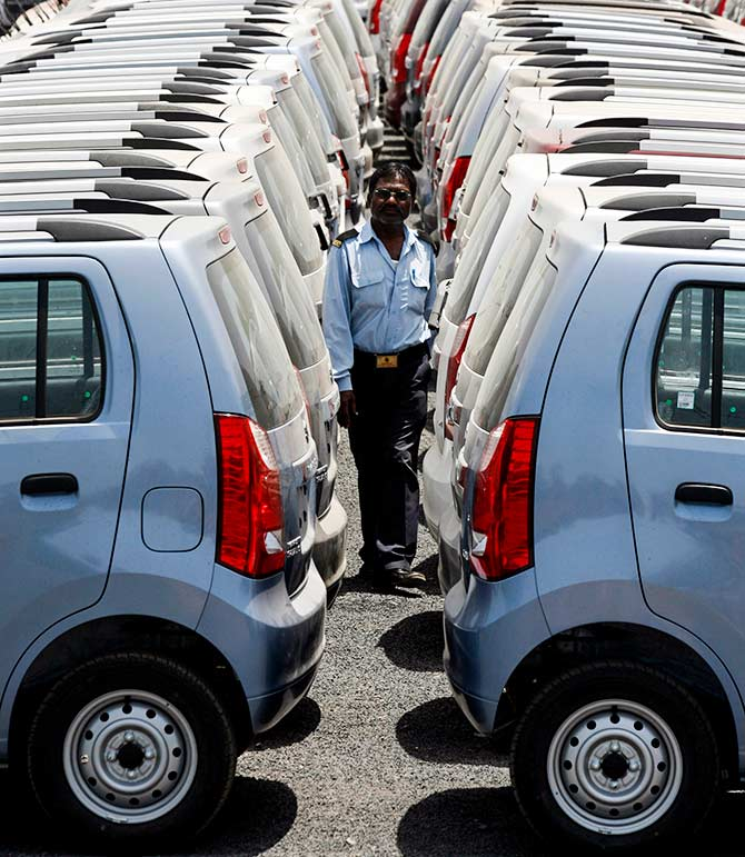 A security personnel officer walks at a Maruti Suzuki stockyard on the outskirts of the western Indian city of Ahmedabad April 26, 2010. Photo: Amit Dave/Reuters