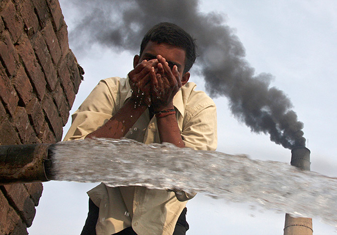 A brick factory spews smoke