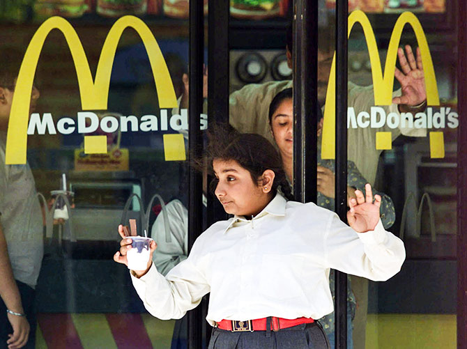 Indian diners leave a McDonald's in New Delhi March 8, 2002. Photo: Kamal Kishore/Reuters
